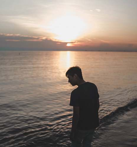 human man on beach outdoors