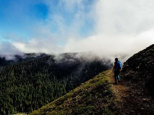 hiking man standing on mountain bald mountain