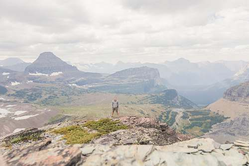 outdoors man standing on top of hill mountain