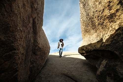 human man walking near rock person