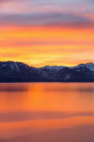sunrise mountains and lake during sunset sunset