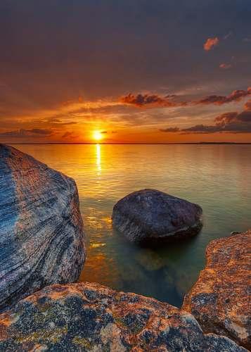outdoors rock on ocean sunset