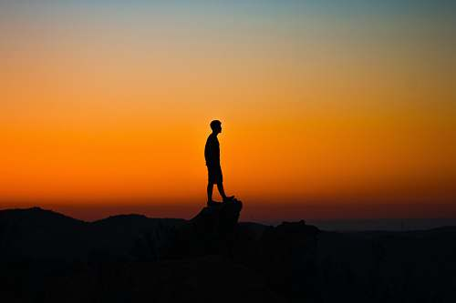 outdoors silhouette of man during sunset sunrise