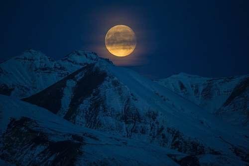 outdoors snow coated mountain at night time alaska