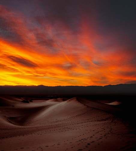 desert sunlight through clouds over mountain outdoors