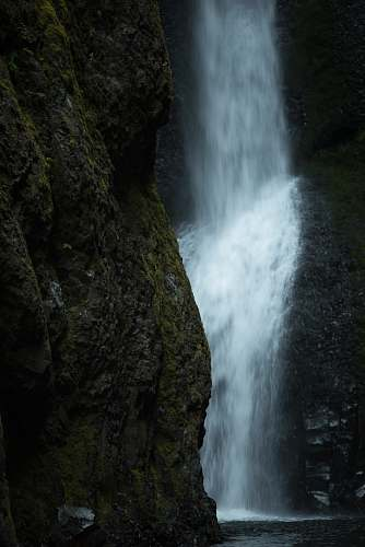 water time lapse photography of flowing waterfall outdoors