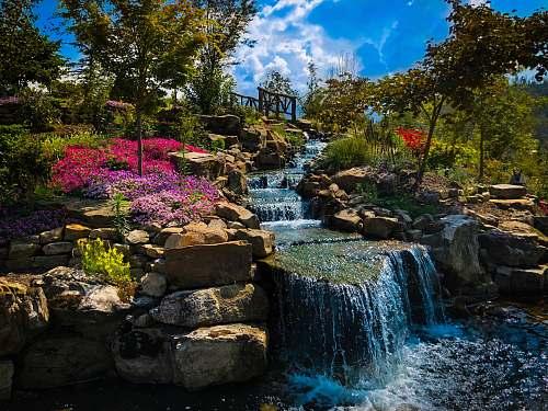 outdoors waterfall between trees water