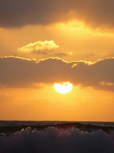 dawn wavy ocean during sunset dusk
