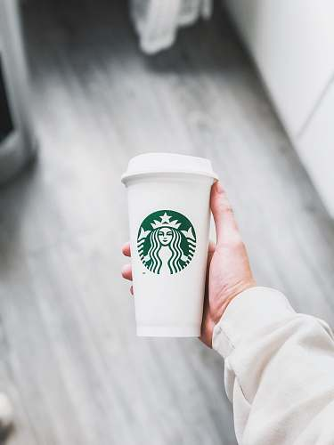coffee cup person holding white Starbucks disposable cup cup