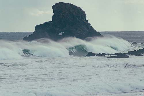 water black rock and seawaves sea