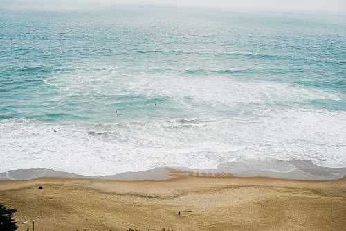 water calm ocean at daytime beach