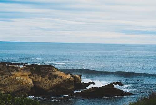 nature ocean shoreline view under blue sky during daytime water