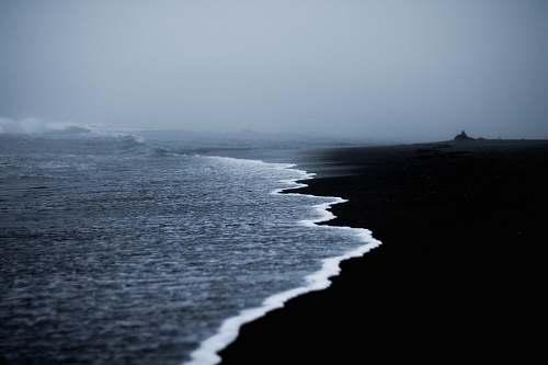 coast ocean water under gray sky water