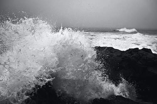 water ocean waves during daytime black-and-white