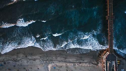 sand black hanging bridge on sea oceanside pier