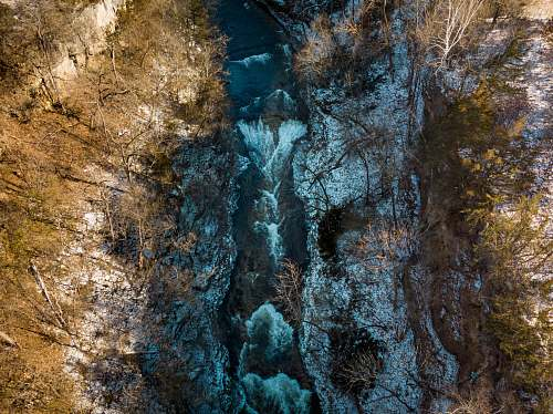 nature aerial photography of waterfalls during day time river