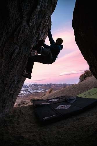 adventure man hiking on rock formation climbing