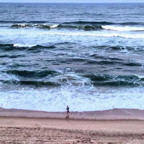 sea man standing seashore water