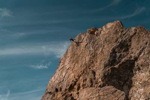 cliff person on brown mountain malibu