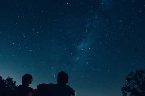 person silhouette photo of two person watching stars human