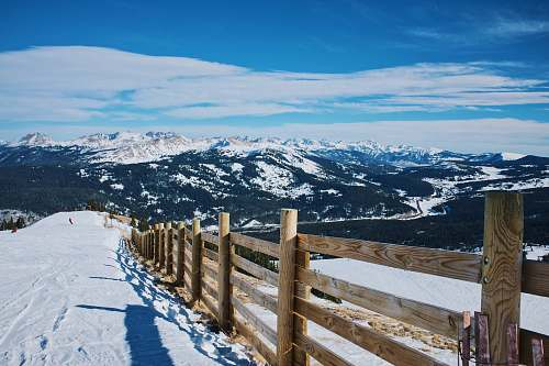 mountain snowfield and brown wooden fence near mountain at daytime alps