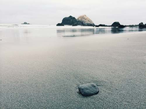 grey black stone on shoreline rock