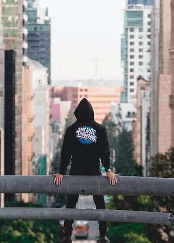 human ban standing on ledge person