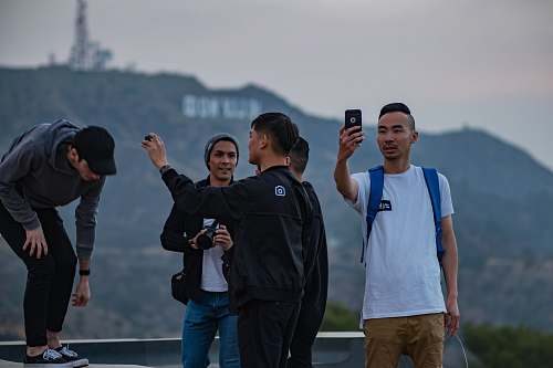 person people taking photo on building human