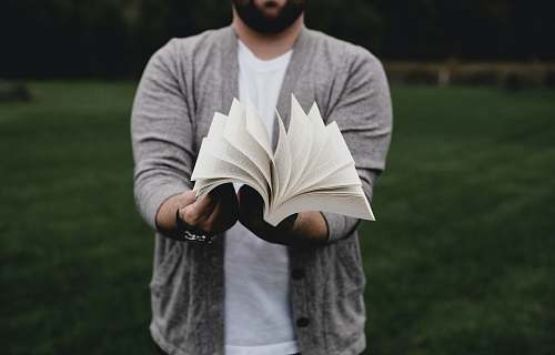 human person opening book person
