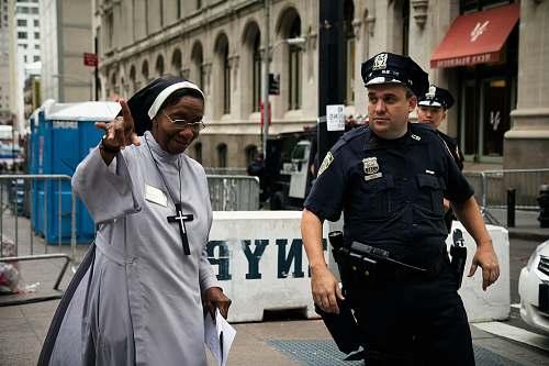 human policeman assist a nun police