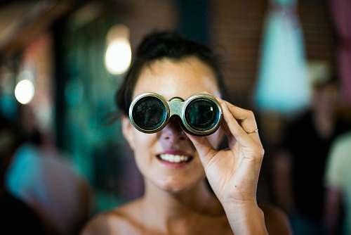 human woman using gray binoculars person