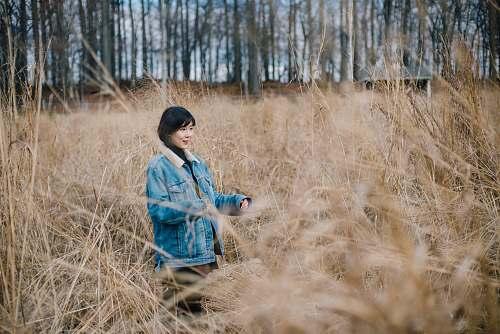 human woman walking on brown grass field person