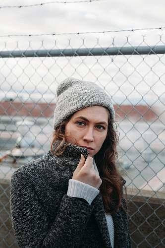 human woman wearing gray knit cap person