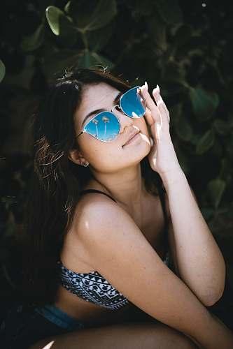 human woman wearing sunglasses person