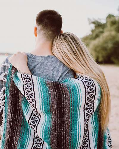 woman woman's hand on man's shoulder blonde