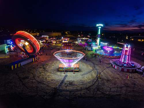 human amusement park at night festival