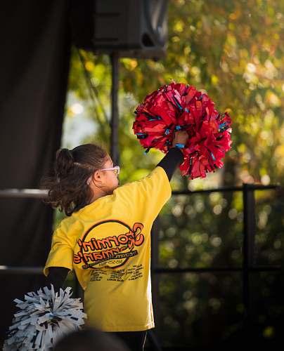 human girl holding cheer dancer pompom plant