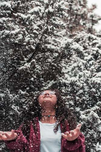 human girl leaning above during with snow people