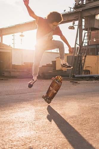 human man skate boarding during daytime skateboard