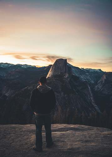 human man standing on rock formation people