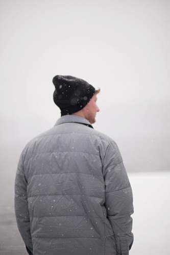 people man wearing gray jacket under snow human