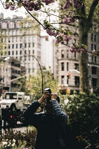 human men holding a camera during daytime new york