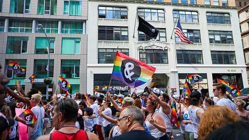 human people holding pride flag flag