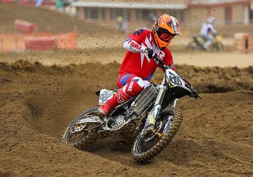 motocross person riding on motocross dirt bike motorcycle