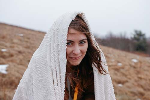 human smiling woman wrapped with white headscarf people