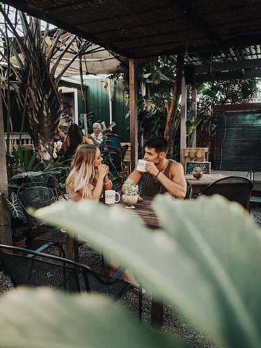 human woman and man sitting in front of table people
