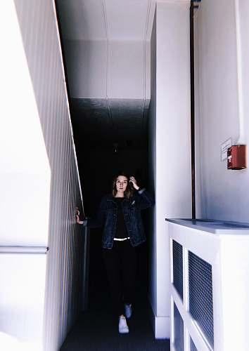human woman standing beside stairs people