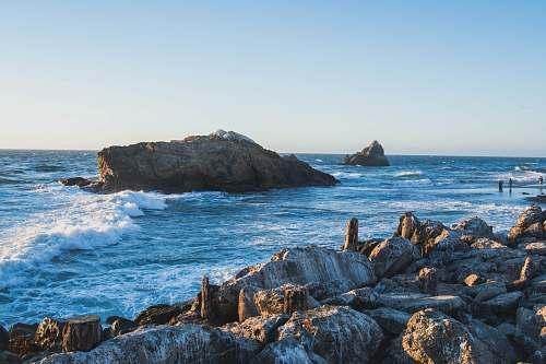 ocean brown stone on the ocean photography sea