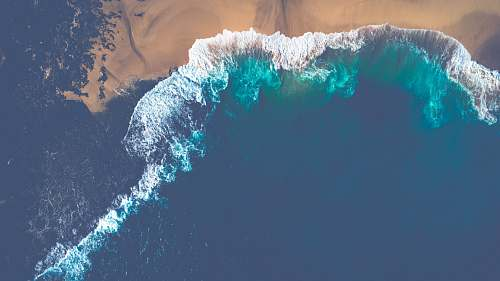 united states aerial view of ocean wave during daytime beach