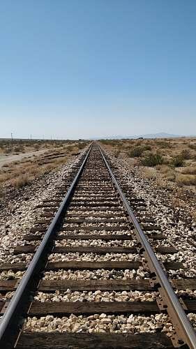 railway train track under blue sky train track